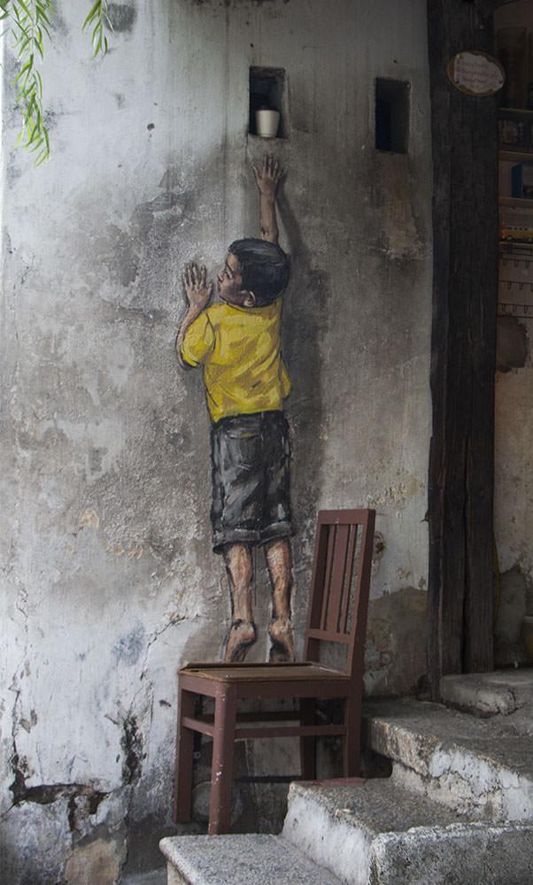 """Bekanntes Kunstwerk """"Boy auf Chair"""" in Georgetown"""